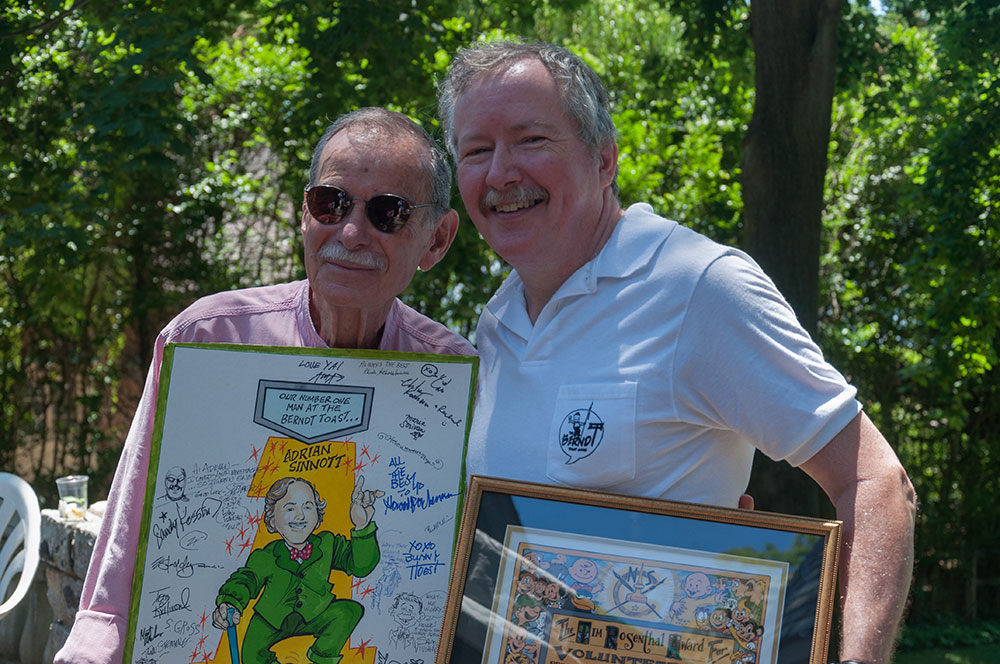 Stan Goldberg presents me with a card he drew and signed by all the cartoonists at the Bunny Bash.